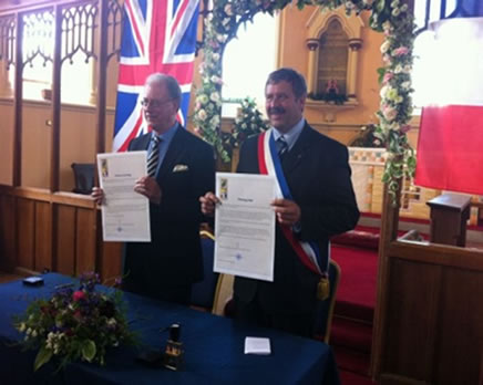 Peter Street the Chairman of the Parish Council and Pascal Zoute the mayor of Chereng signed the official twinning charter at Holy Trinity Church.